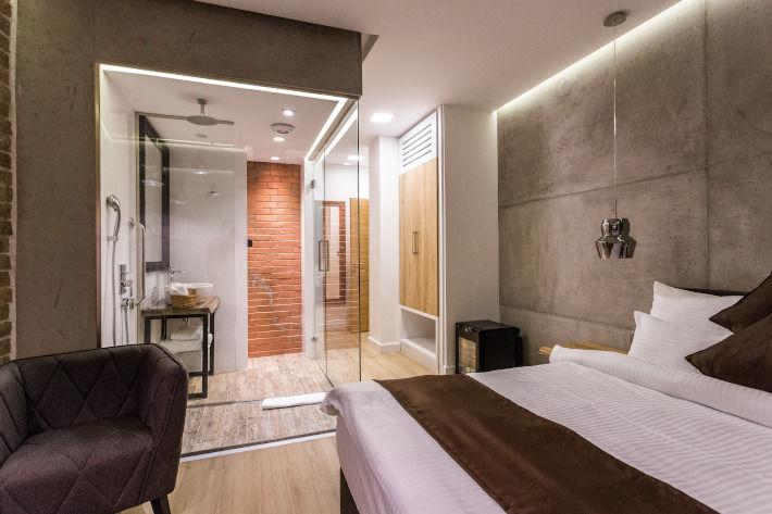 Aranżacja łazienki z sypialnią w stylu loftowym